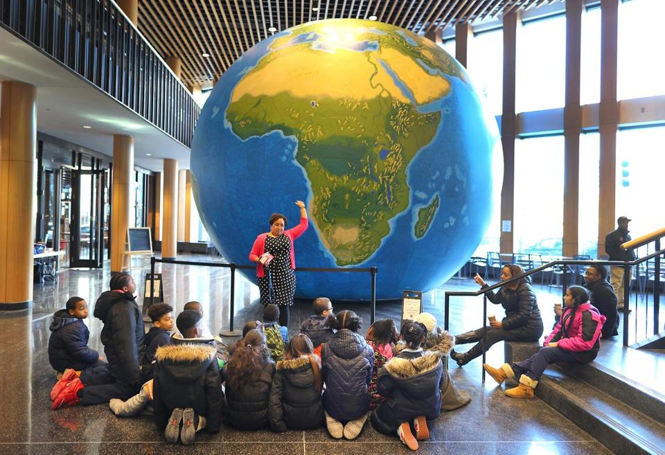 A huge, 20-foot inflatable globe was on display at Boston Public School headquarters in Dudley Square on Thursday, part of an effort to show students what the world really looks like.